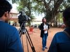 Inbetween painting Kalki gives interviews with local news crews